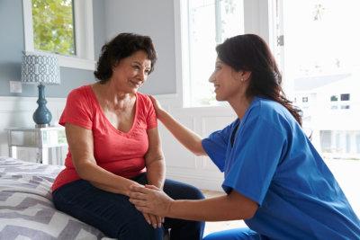 woman talking to a senior woman