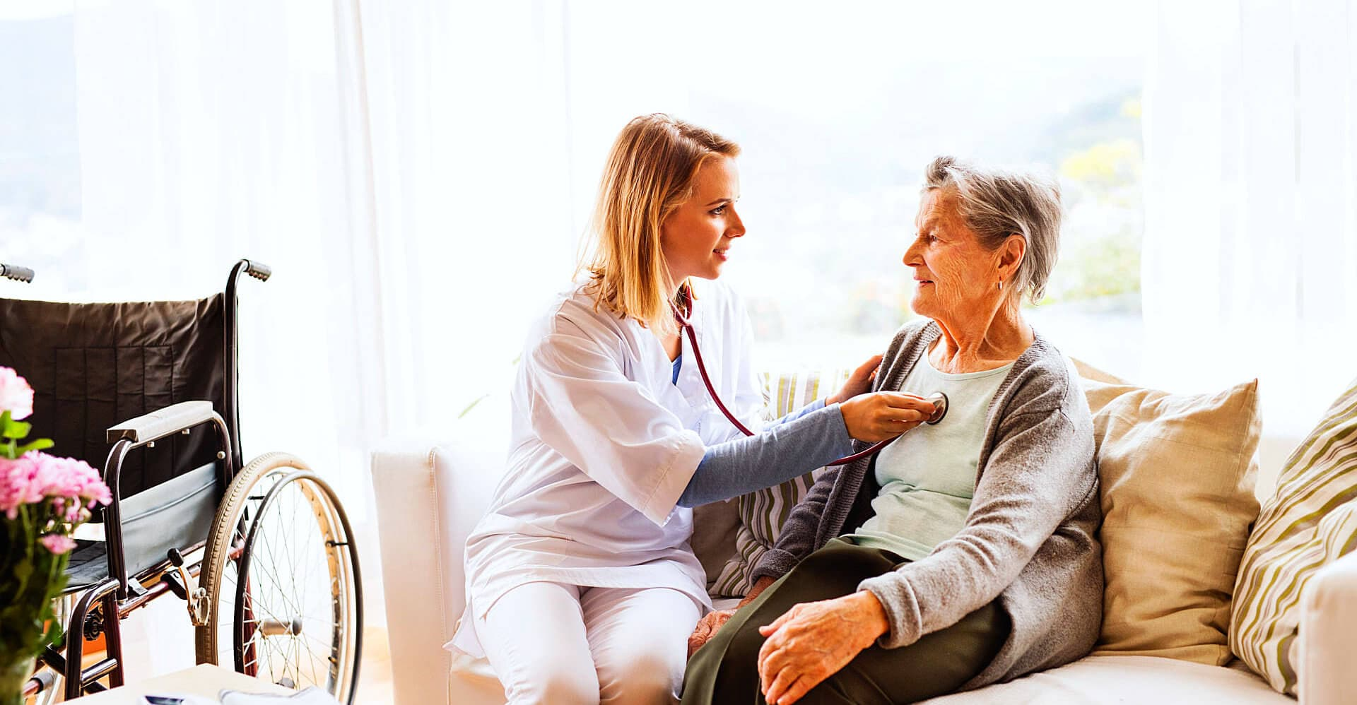 nurse consulting a senior woman