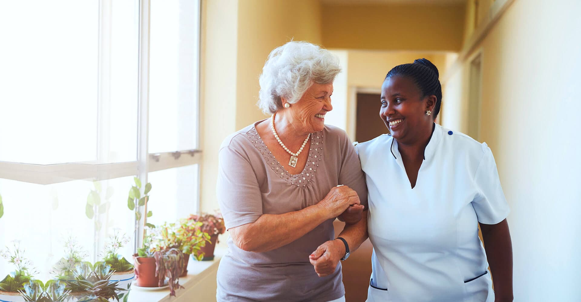 nurse and a senior woman having a conversation