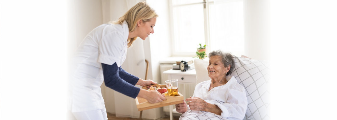 Caretaker assisting senior lady